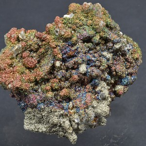 Iridescent Pyrite set on Calcite with Quartz inclusions