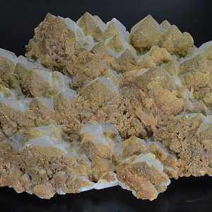 Hexagonal pyramidal Quartz tinged with Calcite