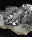 Twinned Galena with Pyrite inclusions set on Quartz