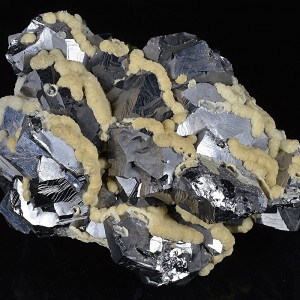 Twinned Galena tinged with Calcite