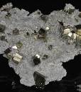 Pyrite on matrix on Quartz