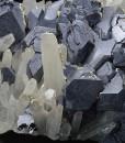 Twinned and truncated Galena on Quartz, Calcite