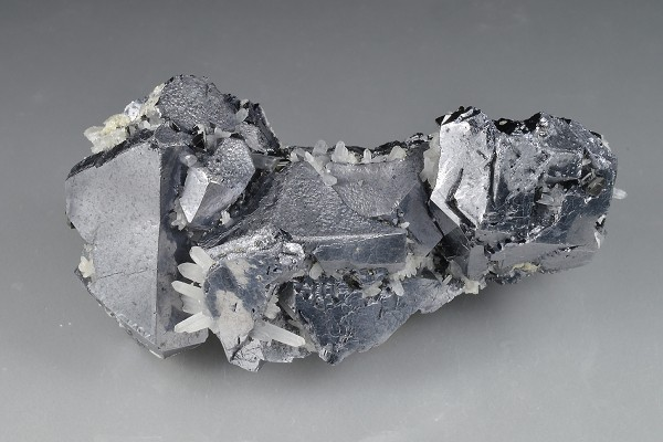 Quartz on twinned and truncated Galena