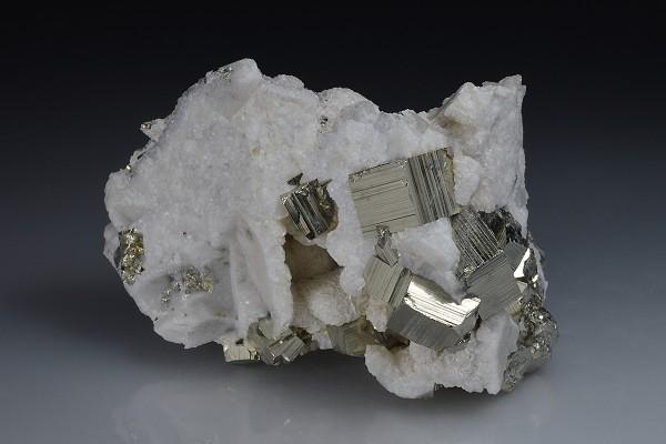 Pyrite on Siderite, Calcite