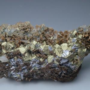 Chalcopyrite on iron oxide Quartz, Galena, Calcite